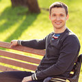 Men sitting bench outdoors portrait man in park Stock Image