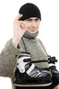 Men with skates gesture shows okay Stock Photos