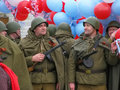 Men in soldier`s uniform with balloons