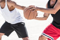 Men in sportswear playing basketball together Royalty Free Stock Photo