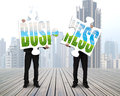 Men standing assembling two puzzles for green business Royalty Free Stock Photo