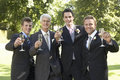 Men toasting champagne flutes at wedding portrait of happy four day Royalty Free Stock Photo
