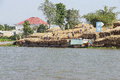 Men unload timber cai rang vietnam feb a cargo boat loaded with cai rang vietnam Stock Image