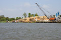Men unload timber cai rang vietnam feb a cargo boat loaded with cai rang vietnam Royalty Free Stock Images