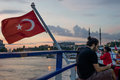 Men using handphone on ferry in evening istanbul turkey jun a man black shirt was sitting at back deck of a bosphorus strait Royalty Free Stock Photography