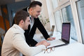 Men using laptops Royalty Free Stock Photo