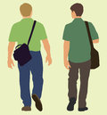 Men walking away carrying bags while they walk Stock Photography