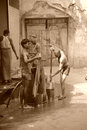 Men washing clothes sepia old delhi india april th their in the city of colour modified to black and white Royalty Free Stock Photos