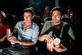 Men watching movie in cinema two young a a Royalty Free Stock Photography