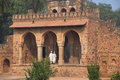 Men in white dresses walking through isa khan niyazi tomb gate humayun s complex delhi india it was the first garden on Royalty Free Stock Image