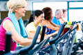 Men and women doing fitness spinning for sport group of young senior people Royalty Free Stock Photos