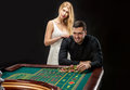 Men with women playing roulette at the casino. Royalty Free Stock Photo