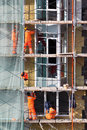 Men works on scaffolding of buildings Royalty Free Stock Photography