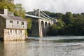 Menai Suspension Bridge view from the bank. Royalty Free Stock Image