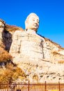 Mengshan buddha stone carving it was built in a d the head was rebuilt in after a d the is located southwest suburbs of Royalty Free Stock Images