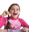 Menina do divertimento com livro de texto Fotos de Stock Royalty Free