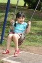 Menina no balanço Fotos de Stock Royalty Free