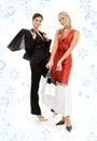 Meninas felizes com sacos e flocos de neve de compra Fotografia de Stock
