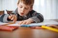 image photo : Young boy drawing at home