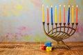 Menorah with candles and dreidel for Hanukkah celebration Royalty Free Stock Photo