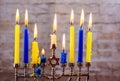 Menorah with candles for Hanukkah against defocused lights Royalty Free Stock Photo