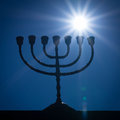Menorah and the star silhouette of jewish lightstand called symbol of winter light festival called hanuka hanukka chanukkah Stock Photos