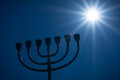 Menorah and the star silhouette of traditional jewish lightstand called symbol of winter light festival called hanuka hanukka Royalty Free Stock Images