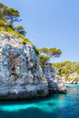 Menorca rocky coast scenery with turquoise water of mediterranean sea near macarella beach Royalty Free Stock Photo