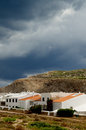 Menorca urbanization classic houses in small between hills under cloudy skies outdoors balearic islands Stock Photos