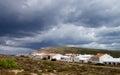 Menorca urbanization classic small between hills under cloudy skies outdoors balearic islands Stock Photography