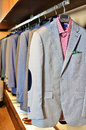 Mens clothing store a luxury with suits Stock Photos