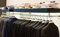 Mens clothing store a luxury with suits and shirts Stock Images
