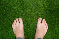 Mens feet standing on grass close up Royalty Free Stock Photo