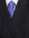 Mens jacket shirt and tie detail of pinstripe suit lapel with purple spotted Stock Image
