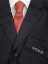 Mens jacket shirt and tie detail of pinstripe suit lapel sleeve buttons with orange speckled Royalty Free Stock Photo