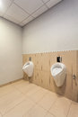 Mens toilet interior of a bright room with urinals Royalty Free Stock Photography