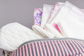 Menstrual tampons and pads in cosmetic bag. Menstruation cycle. Hygiene and protection Royalty Free Stock Photo