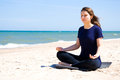 Mental health young woman practicing yoga at sea Royalty Free Stock Images
