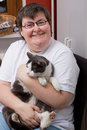 Mentally disabled woman with cat Royalty Free Stock Images