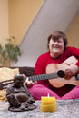 Mentally disabled woman experiences a music therapy Stock Photo