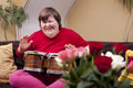 Mentally disabled woman plays drums Royalty Free Stock Photo