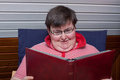 Mentally disabled woman reads a book Royalty Free Stock Photos