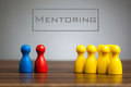 Mentoring concept with pawn figurines on table Royalty Free Stock Photo