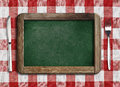 Menu blackboard lying on table Royalty Free Stock Image