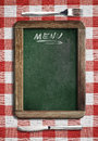 Menu blackboard on table with knife and fork Royalty Free Stock Photo