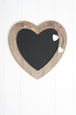 Menu board rustic hanging blackboard decorated with wooden hearts Royalty Free Stock Photos