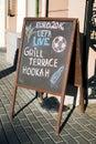 Menu board stand and outdoor cafe euro uefa latvia Stock Photos
