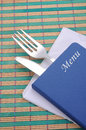 Menu card book with fork and knife on mat background Stock Image