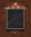Menu chalkboard in wooden frame on vintage brick wall Royalty Free Stock Image