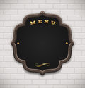 Menu chalkboard in wooden frame on white brick wall Royalty Free Stock Photo